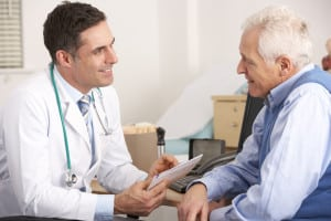 radiation oncologist talking to a senior man prior to treatment