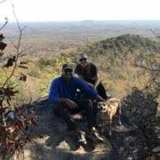 Roshan and Jennifer Prabhu hiking in the Carolinas with their dog