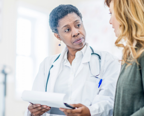 Doctor and patient reviewing cancer treatment plan