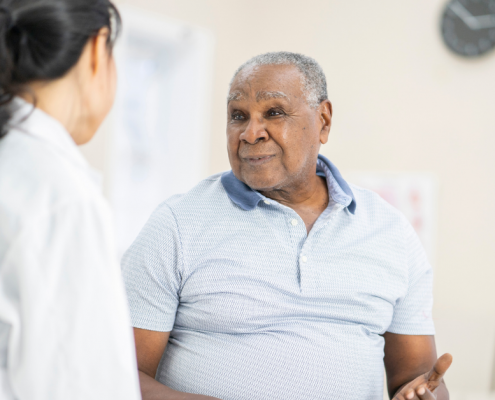 man discussing prostate cancer survival rates with doctor